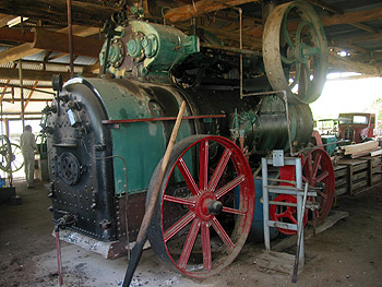 A twin cyclinder steam engine in operating condition on display at the Gayndah Museum